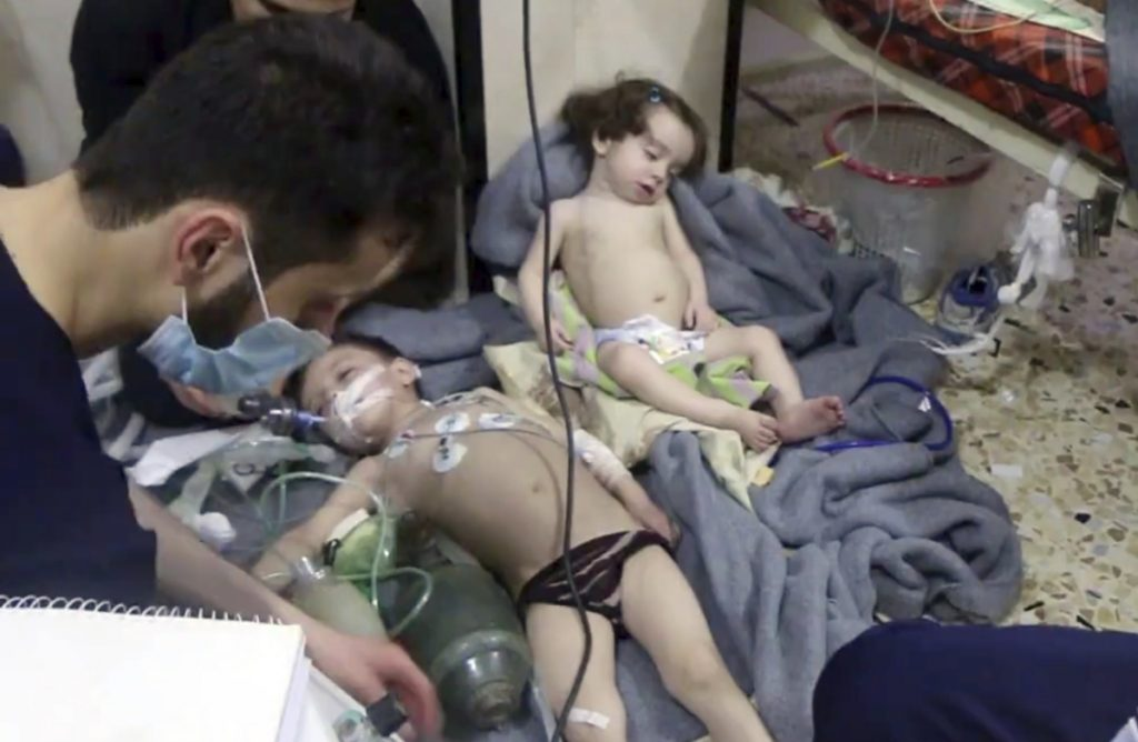 Medical workers treat toddlers after an alleged gas attack in the opposition-held town of Douma, in eastern Ghouta, near Damascus, Syria,on Sunday.