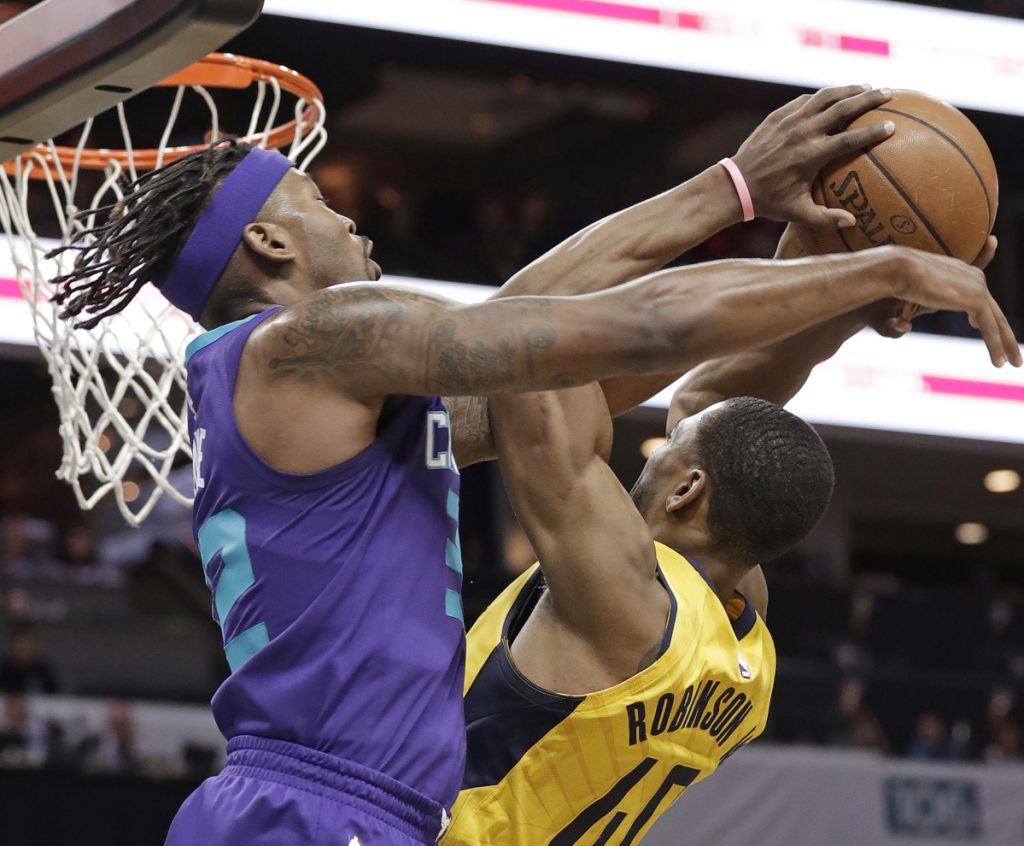 Glenn Robinson III of the Indiana Pacers, right, is fouled by Julyan Stone of the Charlotte Hornets during Indiana's 123-117 victory.