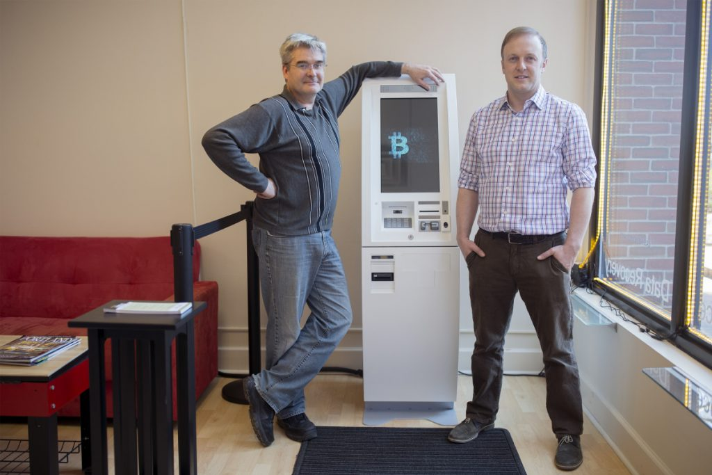 """Arnold Jackson, left, and Daren Hebold, co-founders of the Luxolo Financial company, expect the use of cryptocurrency to grow fast. """"I liken this to email in 1992"""" when few people had heard of it, and then it became ubiquitous, Hebold said."""