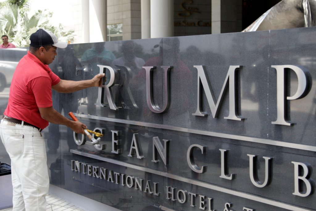 A worker removes lettering from a marquee at the former Trump Ocean Club International Hotel & Tower in Panama City, Panama, where Trump management was evicted.