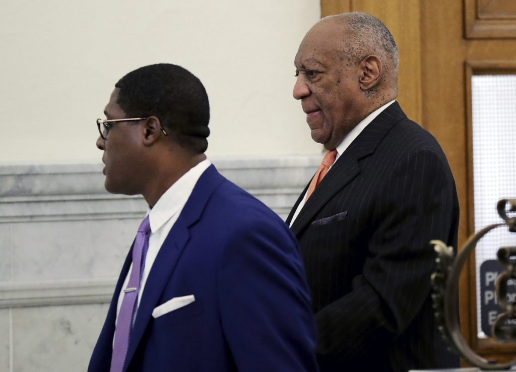 Actor and comedian Bill Cosby, right, arrives for his sexual assault retrial at the Montgomery County Courthouse in Norristown, Pa., on Tuesday.