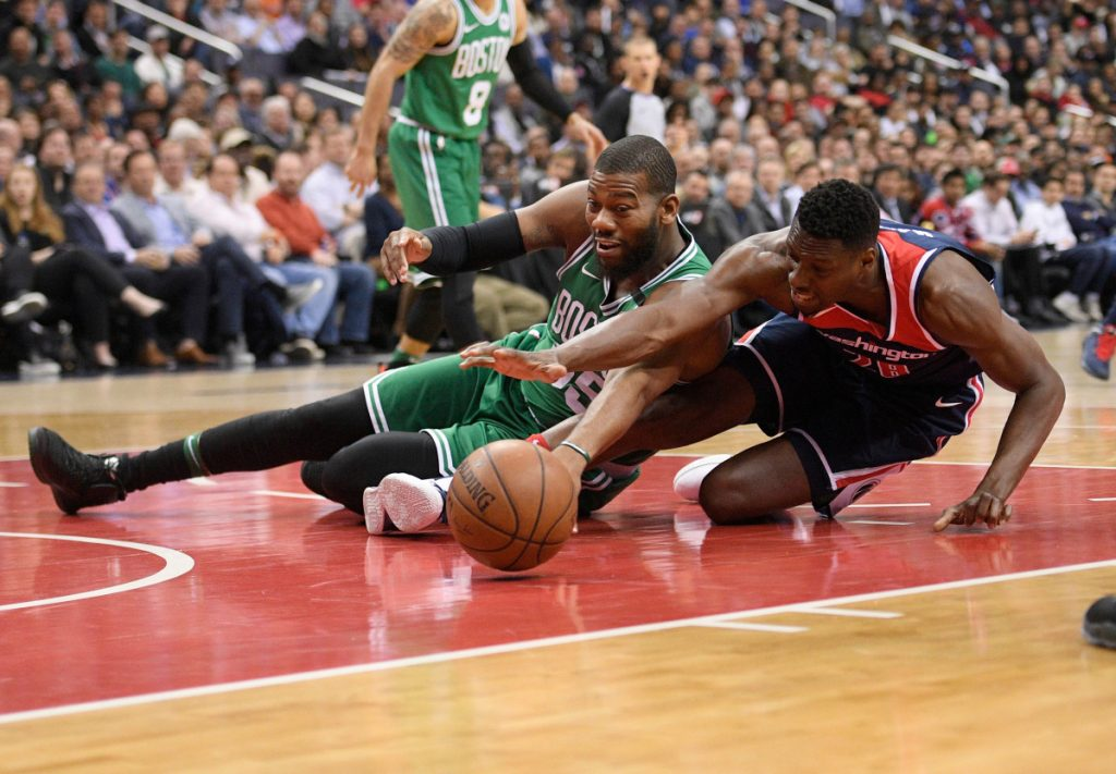 Washington's Ian Mahinmi, right, battles for the ball with Boston's Greg Monroe in the first half Tuesday at Washington.