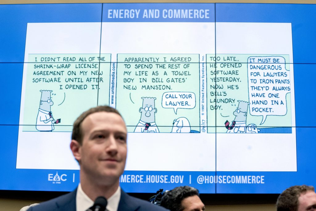 A cartoon is displayed during questioning by Rep. Michael Burgess, R-Texas, of Facebook CEO Mark Zuckerberg at a House Energy and Commerce hearing on Capitol Hill in Washington on Wednesday about the use of Facebook data to target American voters in the 2016 election and data privacy.