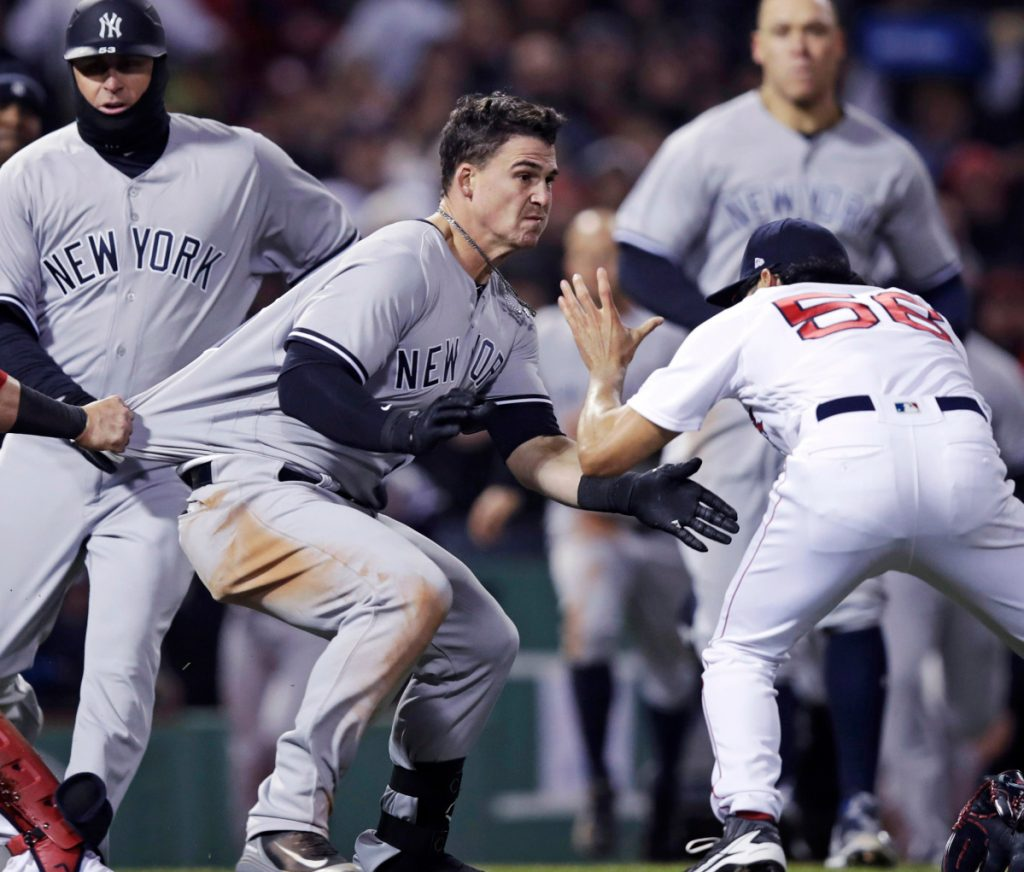 New York Yankees Tyler Austin center rushes Boston Red Sox relief pitcher Joe Kelly right after being hit by a pitch during the seventh inning of a baseball game at Fenway Park in Boston Wednesday