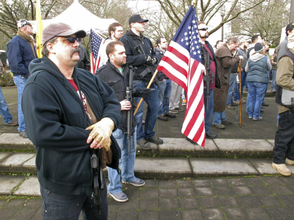 Pro-gun demonstrators attend at a rally outside the state Capitol in Salem, Oregon, in 2013. Organizers are encouraging gun rights supporters to bring unloaded weapons to rallies at state capitols across the U.S. this weekend to counter a recent wave of student-led protests against gun violence.