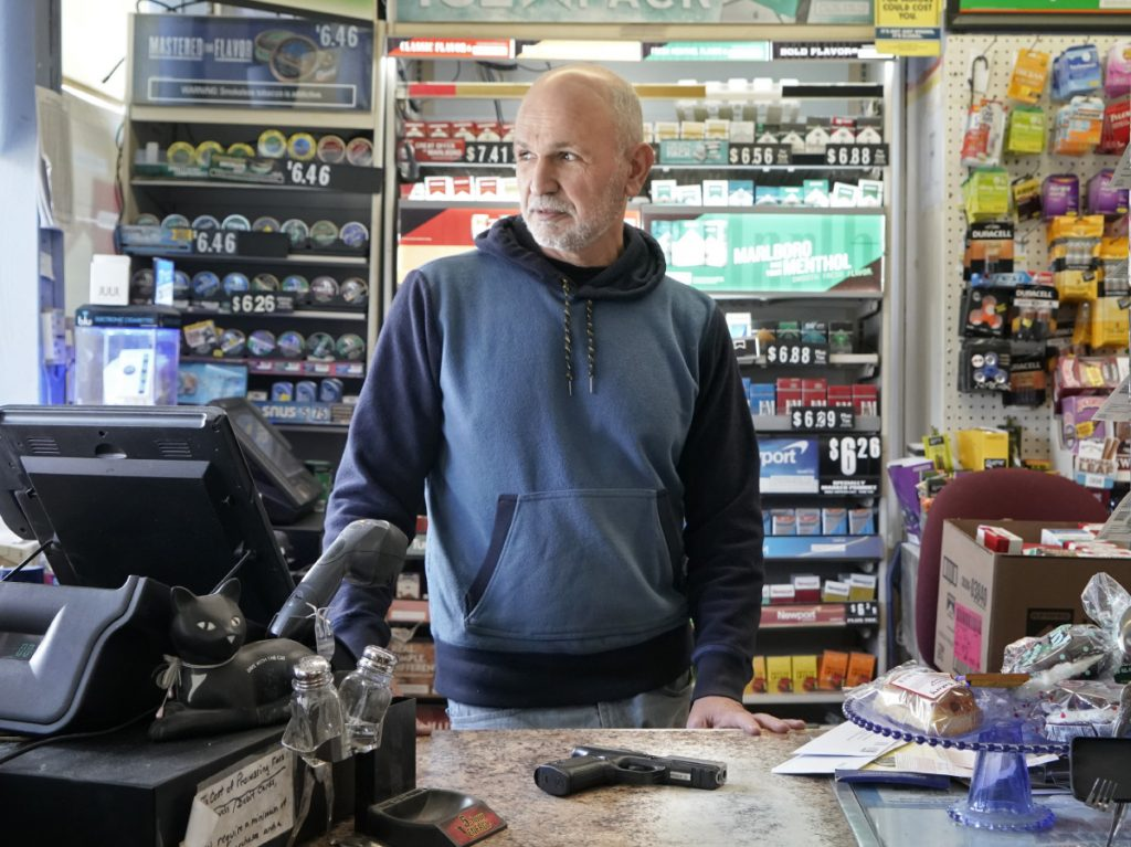 Rafi Jacobi, owner of the Coastal Convenience store in Old Orchard Beach, says he now keeps a gun behind the counter.