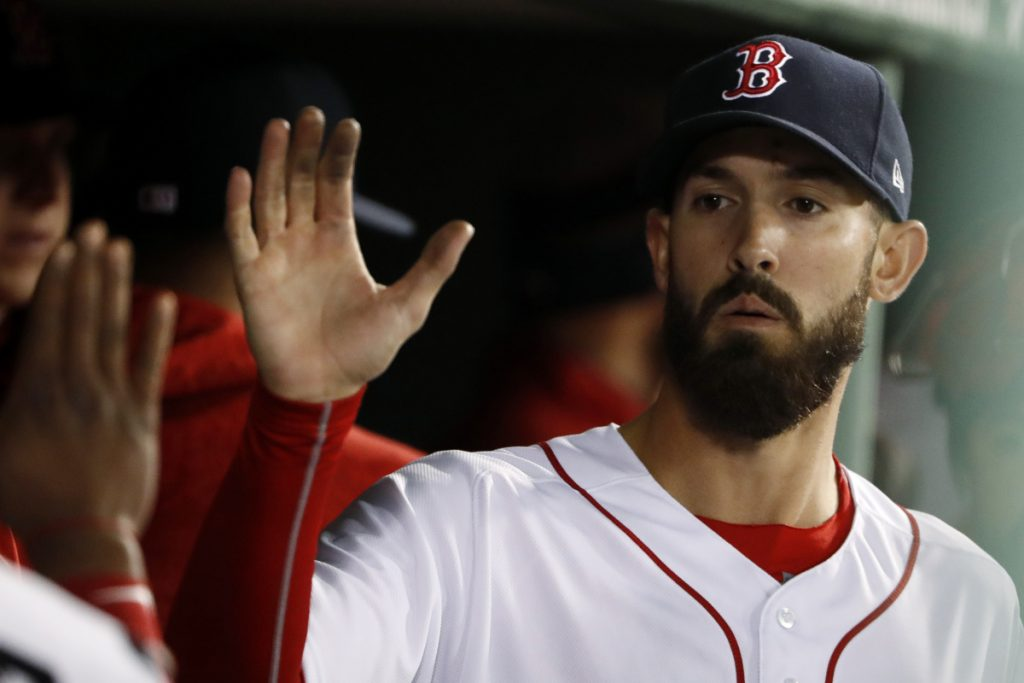 Boston Red Sox starting pitcher Rick Porcello is congratulated in the dugout after leaving after the seventh inning Thursday night against New York. Porcello took a no-hitter into the seventh inning, losing it on a lead off double to Aaron Judge, in Boston's 6-3 win.