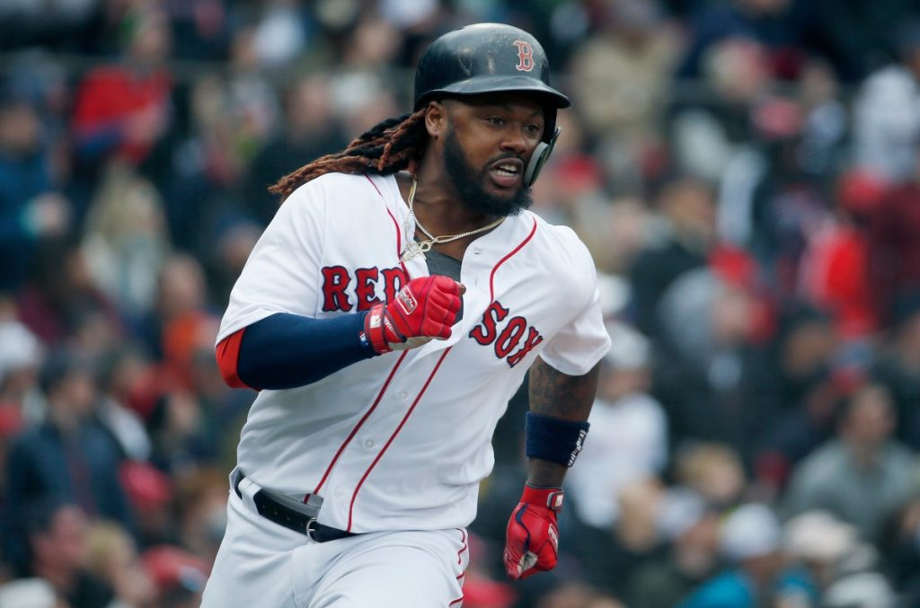 Boston's Hanley Ramirez runs on his two-run double during the fourth inning of Saturday's game against Baltimore in Boston. The Red Sox won, 10-3.