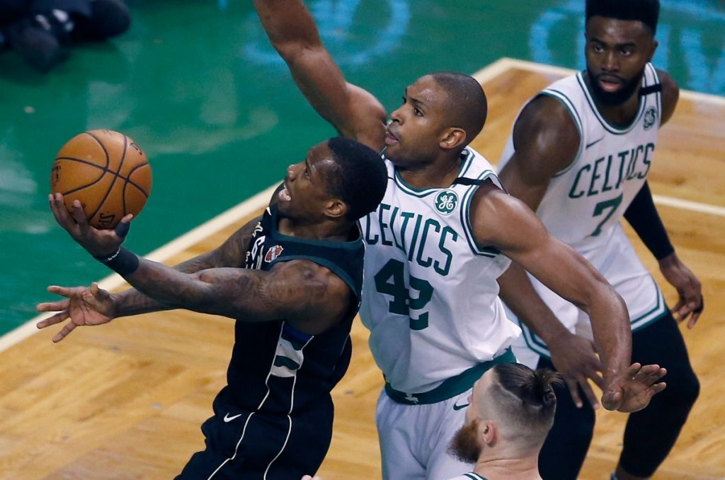 Milwaukee's Eric Bledsoe goes up to shoot in front of Boston's Al Horford during Game 1 of their first round NBA playoff series on Sunday in Boston.