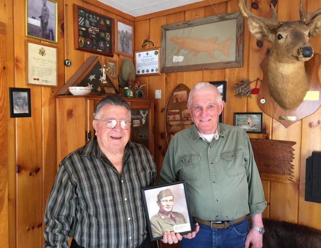 Standish Legion Post Commander Don Roy, left, and Post Historian Hal Ware hold a photo of Pfc. Stuart W. Hooper, believed to be the first Standish resident to die in World War II.