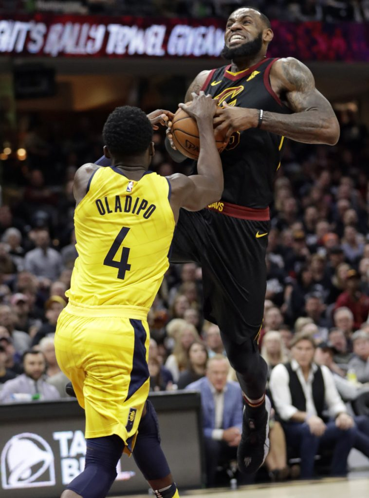 LeBron James of the Cleveland Cavaliers attempts to drive against Victor Oladipo of the Indiana Pacers during the first half of the Pacers' 98-80 victory Sunday in Game 1 of their first-round series.