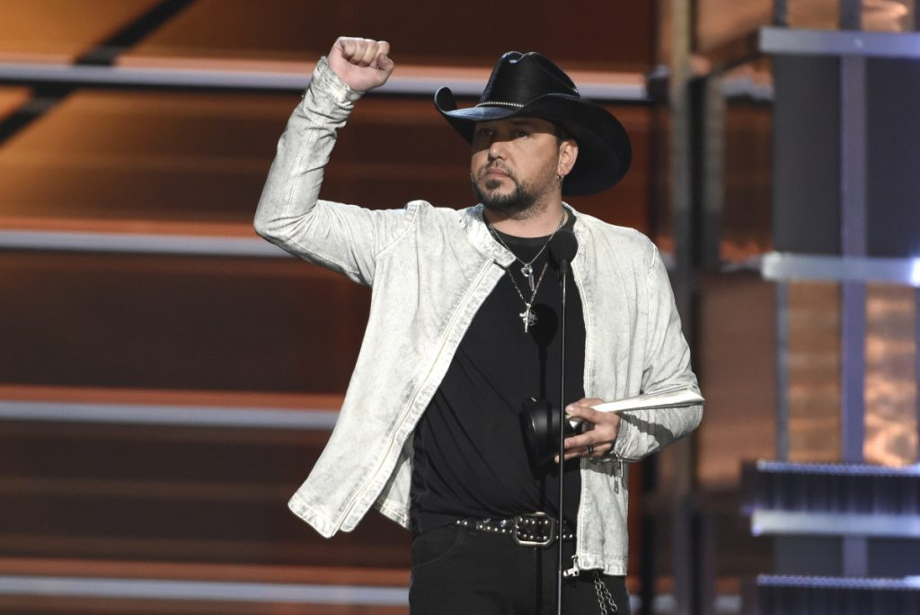 Jason Aldean accepts the award for entertainer of the year at the 53rd annual Academy of Country Music Awards on Sunday in Las Vegas.
