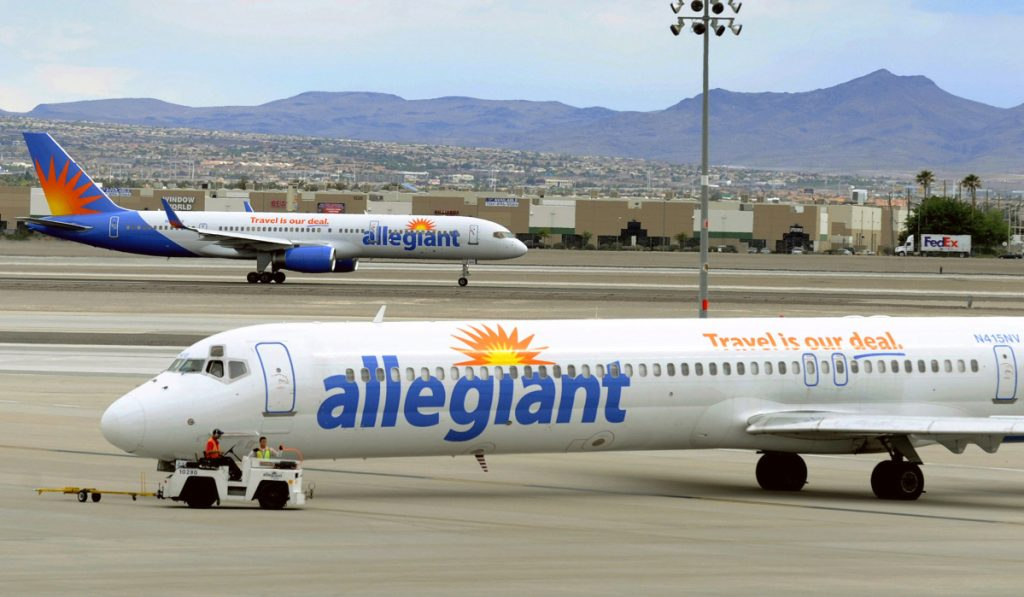 Two Allegiant Air jets taxi at McCarran International Airport in Las Vegas in 2013. The airline's shares continued to fall in the aftermath of a news report that raised safety questions.
