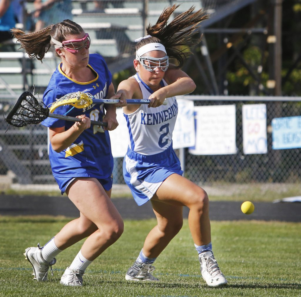 KENNEBUNK, ME - JUNE 15: Kennebunk #2 Hallie Schwartzman holds off Falmouth #21 Sydney Bell during second half action at Kennebunk in the Class B South girls lacrosse regional final. (Photo by Jill Brady/Staff Photographer)