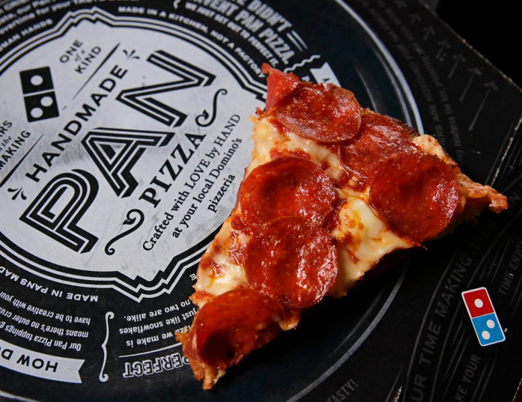 Domino's says that its drivers can meet customers at beaches, parks and landmarks to hand over pizza, cheesy bread or chicken wings. In all, Domino's said it can deliver to 150,000 outdoor locations in the United States, including under the Gateway Arch in St. Louis, or the beaches of Siesta Key, Fla.