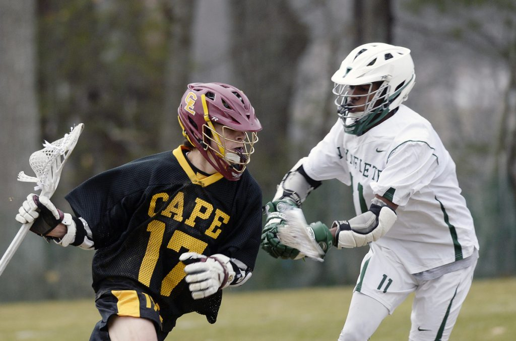 Cape Elizabeth, a Class C school by enrollment, moved up to be in Class A, the most competitive league. Jacob Brydson, left, had five goals and four assists in the opener.