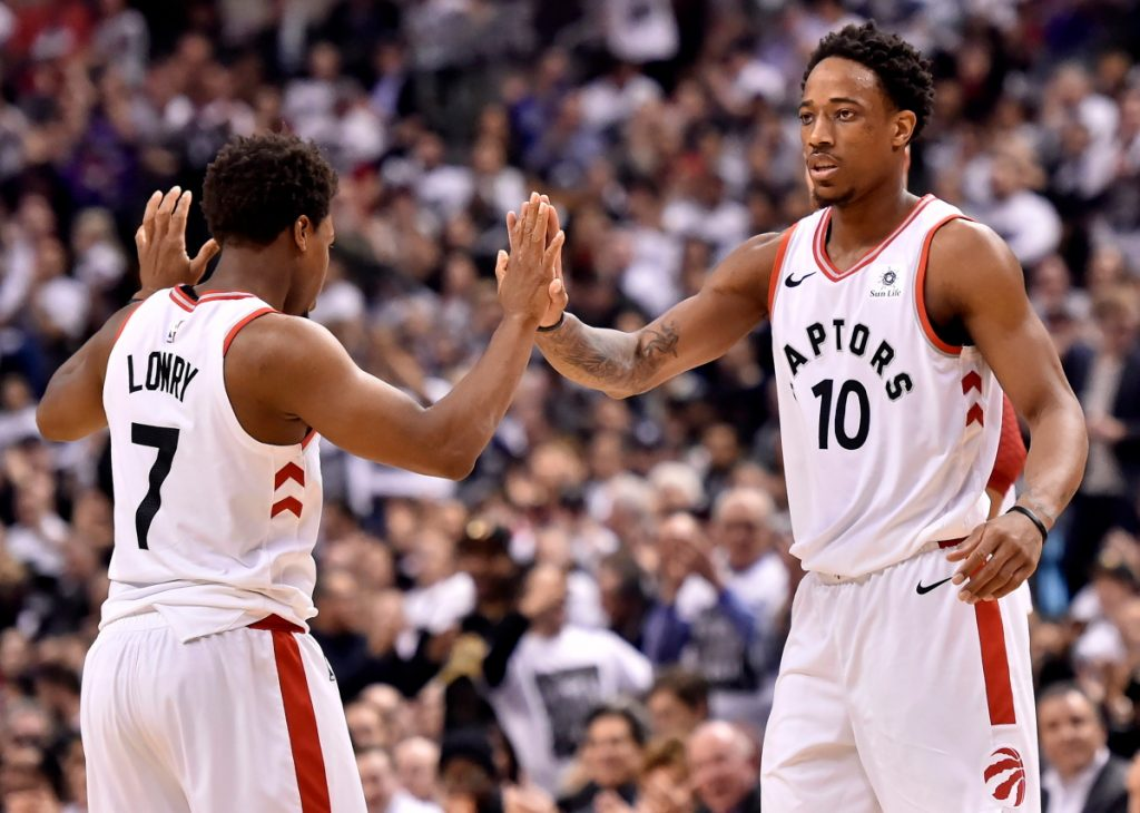 Toronto's Kyle Lowry, left, and teammate DeMar DeRozan celebrate a basket against the Washington Wizards during Tuesday's first-round playoff game in Toronto. The Raptors won to take a 2-0 series lead.