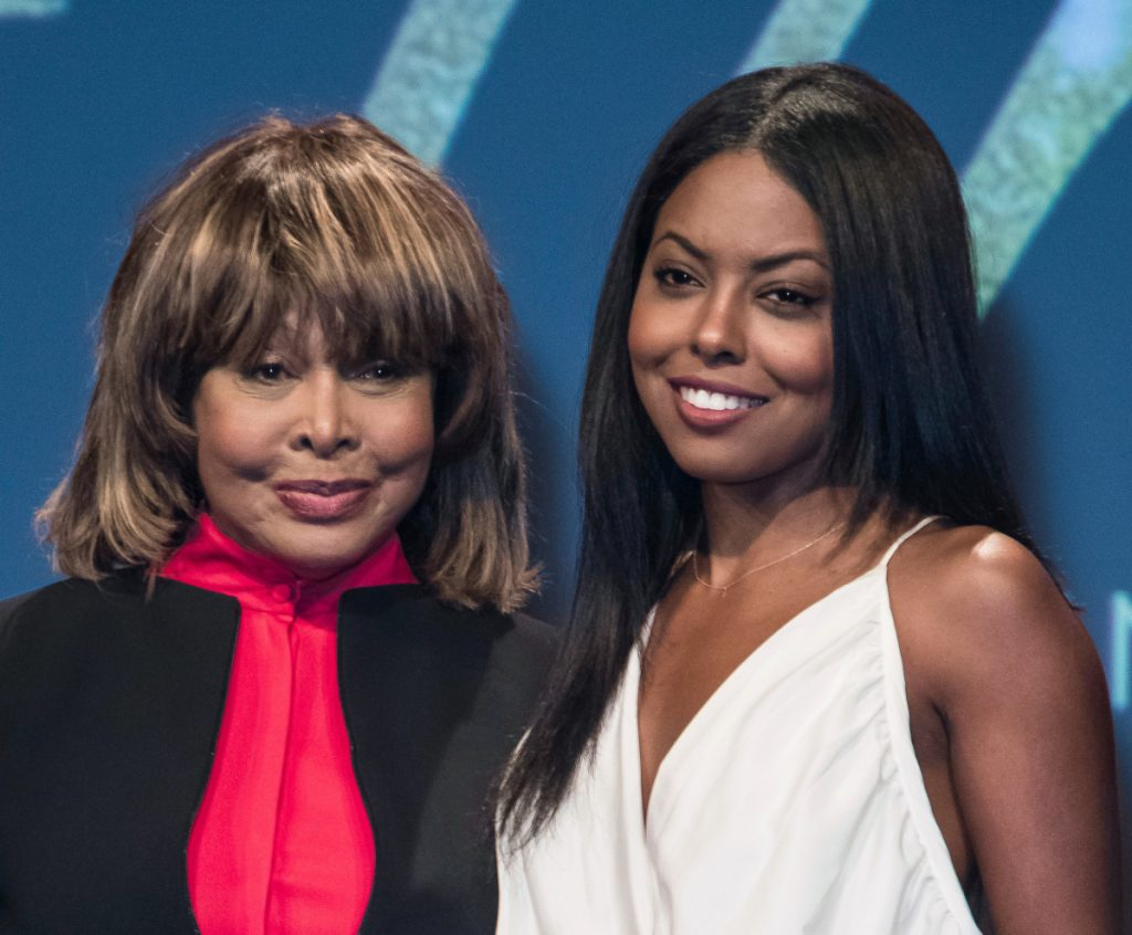 "Tina Turner, left, poses with actress Adrienne Warren, who plays Turner in the musical ""Tina."" Turner attended opening night Tuesday and joined the cast on stage for the curtain call."