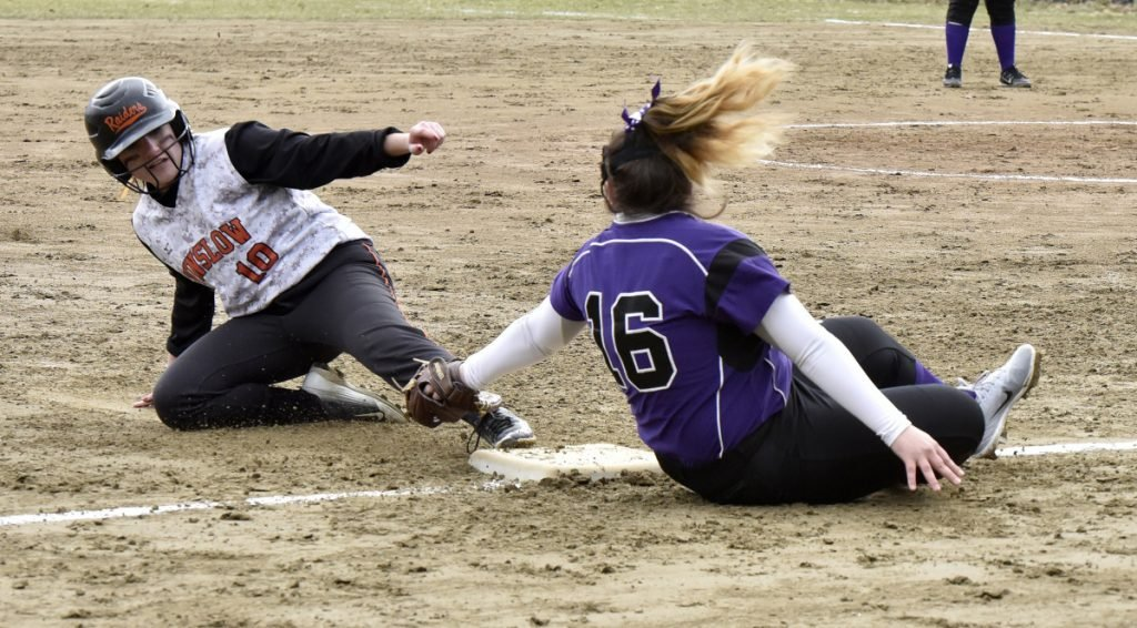Winslow's Cassie Demers slides safe into third base as Waterville's McKayla Nelson attempts the tag Wednesday in Winslow.