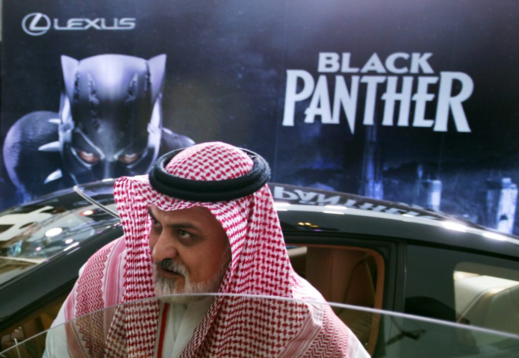 "A visitor checks out a Lexus car, similar to a one used in the ""Black Panther"" film, on display Wednesday outside an invitation-only screening, at the King Abdullah Financial District Theater, in Riyadh, Saudi Arabia."