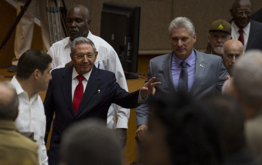Cuba's President Raul Castro, center left, enters the National Assembly followed by his successor Miguel Diaz-Canel, center right, on Wednesday.