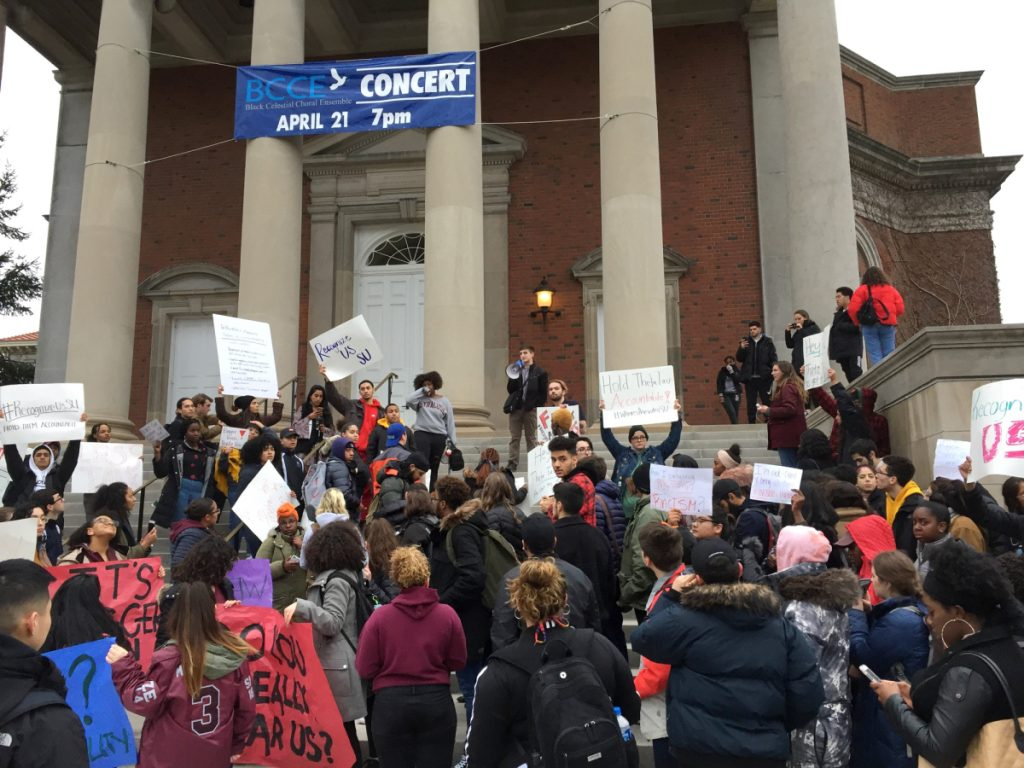 Syracuse University students gather outside Hendricks Chapel on Wednesday to protest a video made by members of Theta Tau fraternity.