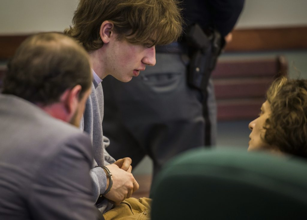 Jack Sawyer, center, shown in Vermont Superior Court on Tuesday, has pleaded not guilty to planning a school shooting at Fair Haven Union High School.