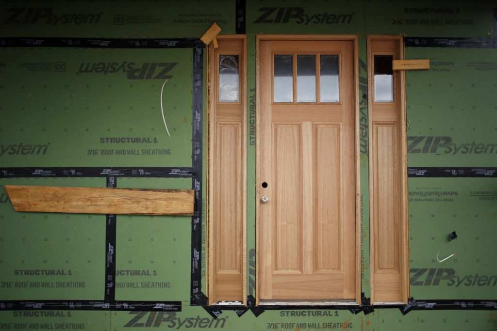 The front door of a home under construction is seen in Louisville, Ky., in March. MUST CREDIT: Bloomberg photo by  Luke Sharrett.