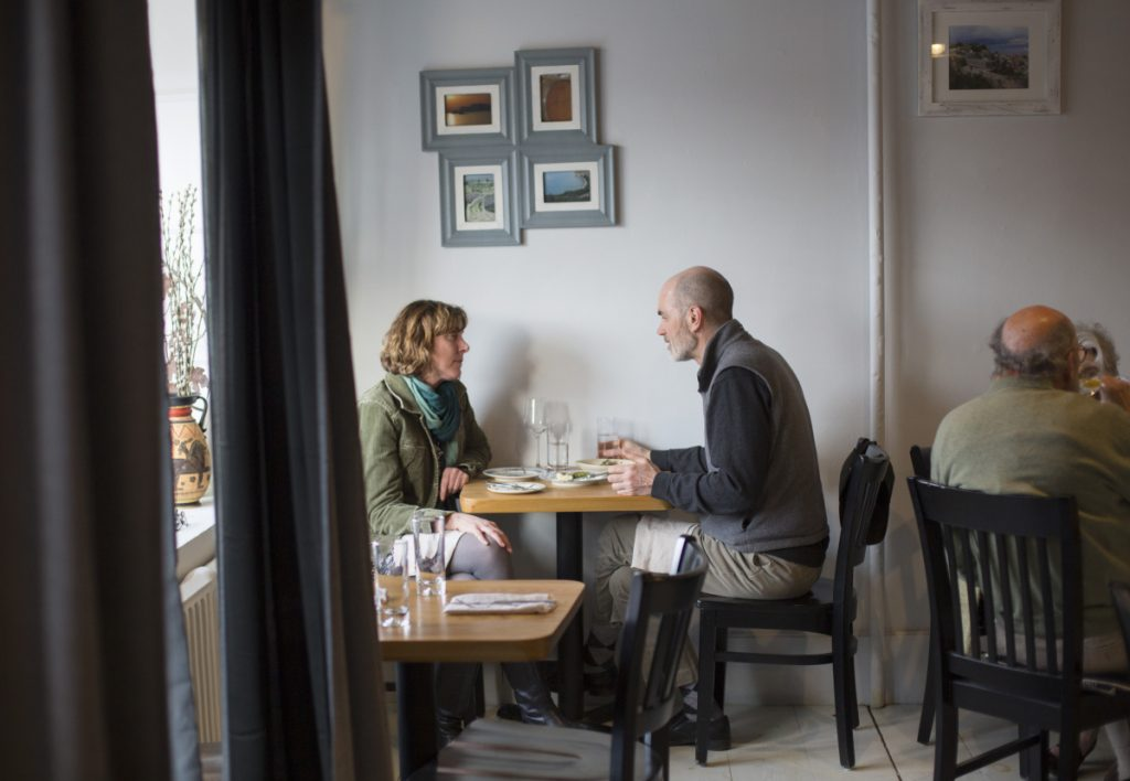 Amanda Myers of Freeport and Erich Bohrmann of Yarmouth share a meal at Taverna Khione, which is in the space formerly occupied by Trattoria Athena, also operated by chef Marc Provencher.