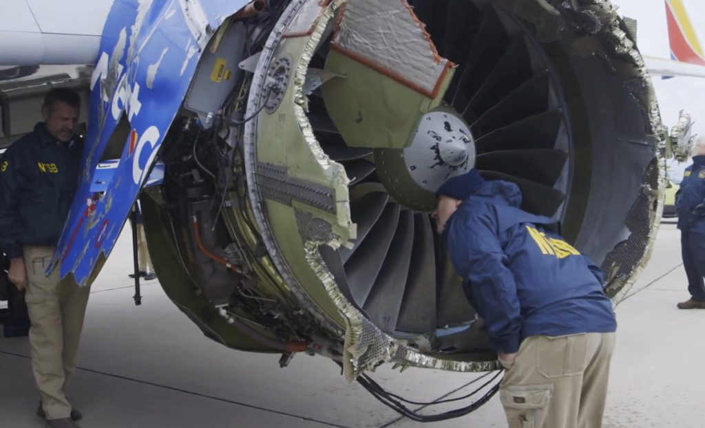 National Transportation Safety Board investigators examine damage to the engine of a Southwest Airlines plane that made an emergency landing at Philadelphia International Airport on Tuesday. Under a new FAA order, all CFM 56-7B engines that have gone through at least 30,000 takeoffs or landings must be inspected within 20 days.