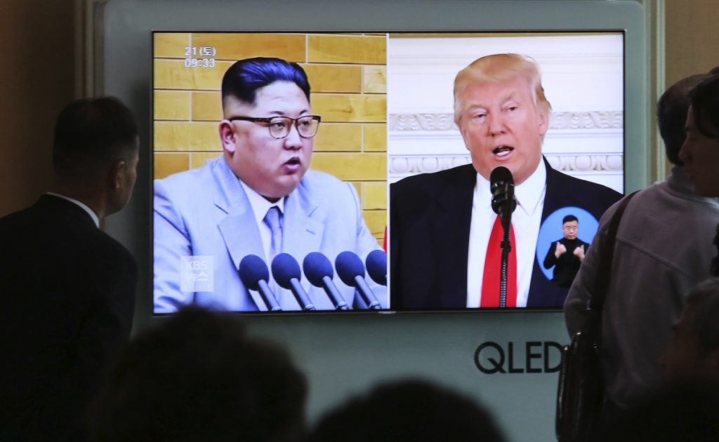 People watch a TV screen showing President Trump and North Korean leader Kim Jong Un during a news show at the Seoul Railway Station in Seoul, South Korea, on Saturday.
