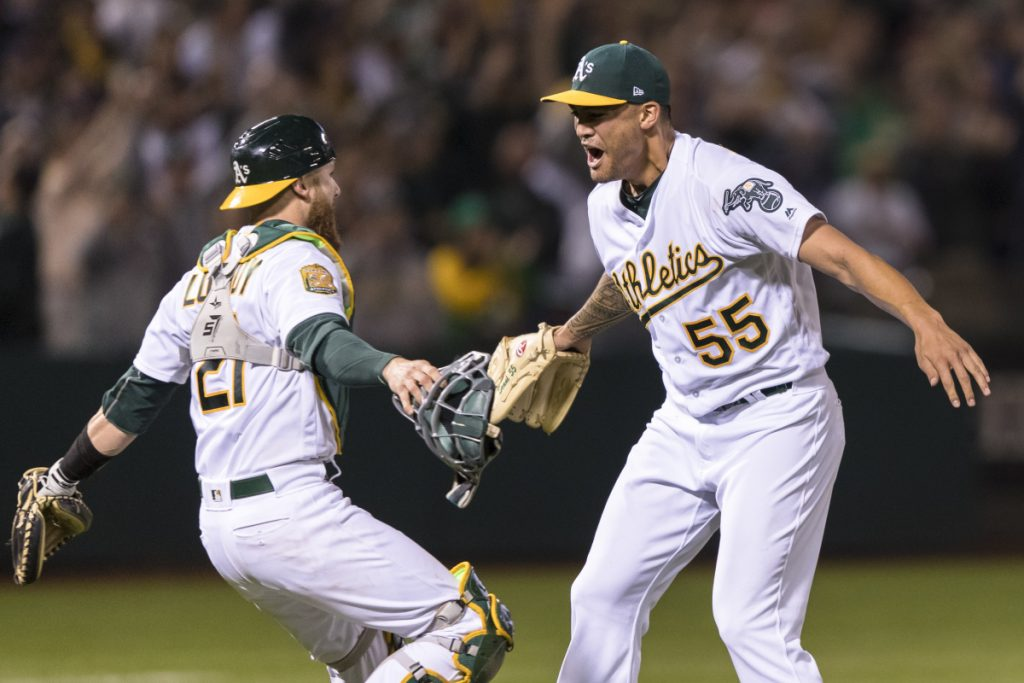 Athletics pitcher Sean Manaea, right, celebrates with catcher Jonathan Lucroy after pitching a no-hitter against the Boston Red Sox on Saturday night in Oakland, Calif. The A's won 3-0.