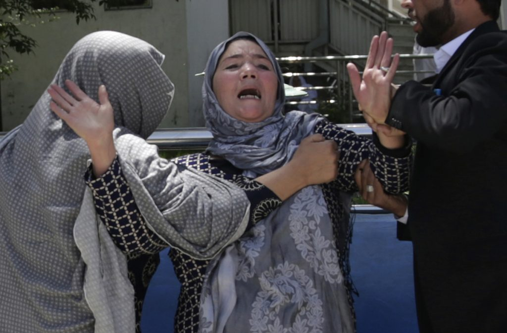 A woman cries at a hospital after she lost her son in a suicide attack on a voter registration center in Kabul, Afghanistan, on Sunday.