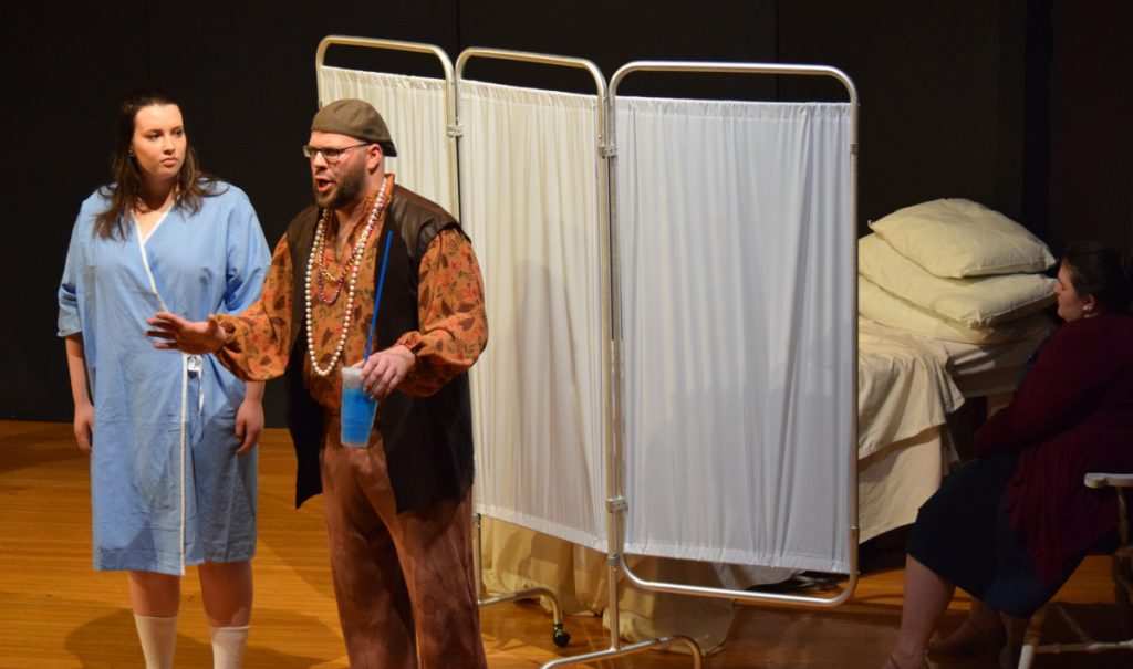 """University of Southern Maine students Rachel Shukan as Girl and David Myers Jr. as Slushie Guy perform in the opera """"Girl in Six Beats."""""""