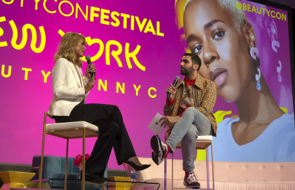 Paris Hilton, left, appears with moderator Phillip Picardi Saturday during the Beautycon Festival NYC.