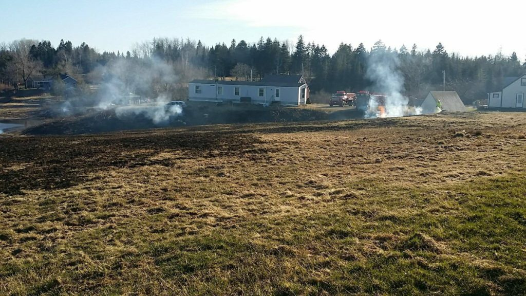 The photograph of the smoldering fields caused by a brush fire Monday was taken by the Maine Forest Service in Machiasport. The brush fire burned between 6 and 8 acres.