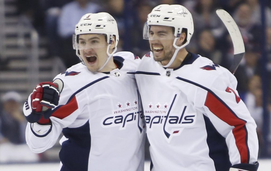 Washington's Dmitry Orlov, left, celebrates his goal against Columbus' Matt Niskanen during the first period of Game 6 of their first-round series Monday in Columbus, Ohio.