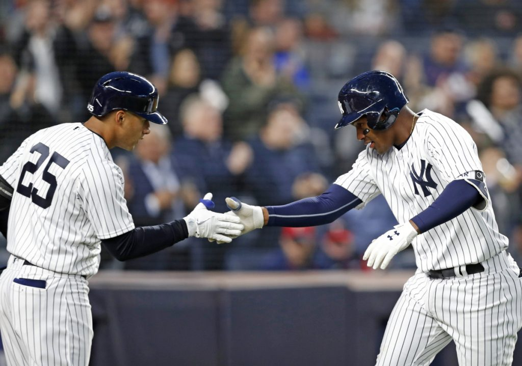 Gleyber Torres, left, congratulates teammate Miguel Andujar after Andujar hit a solo home run Monday night for the New York Yankees during the second inning of a 14-1 victory against the Minnesota Twins at Yankee Stadium.