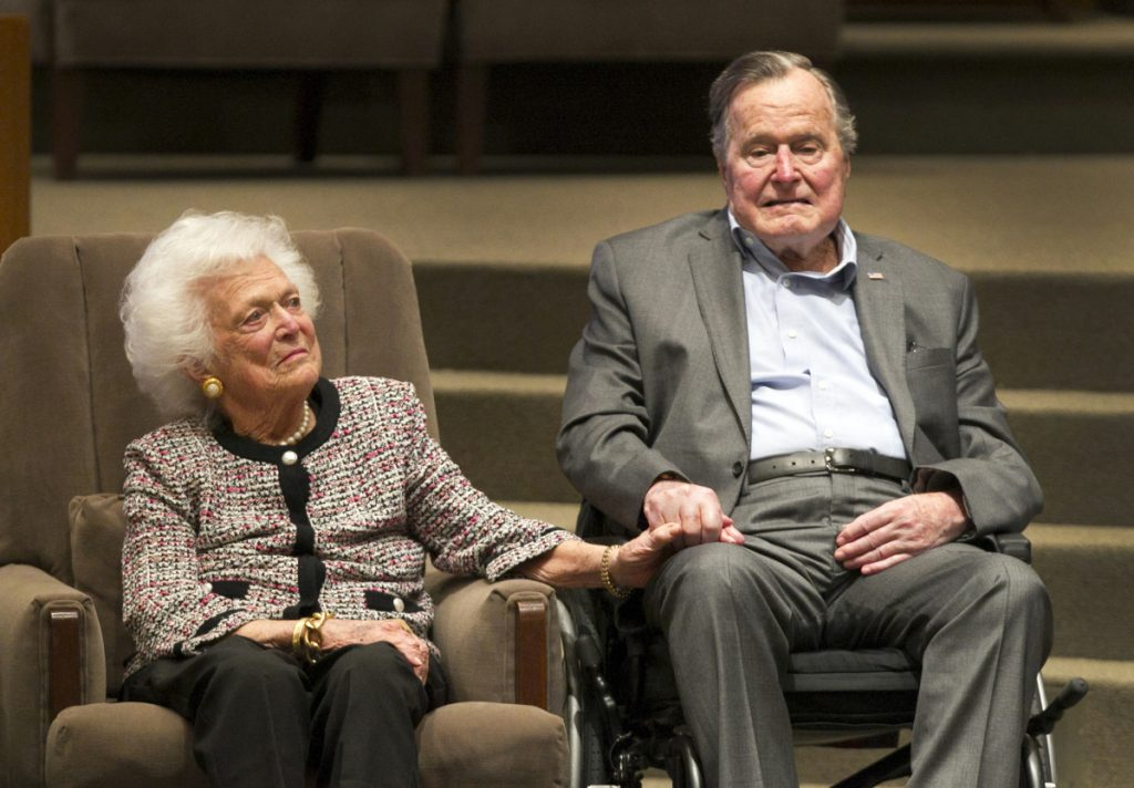 Former President George H.W. Bush and former first lady Barbara Bush attend an event in March 2017. George, who will turn 94 in June, was hospitalized Sunday, a day after Barbara's funeral, with sepsis, an infection that spread to his bloodstream.