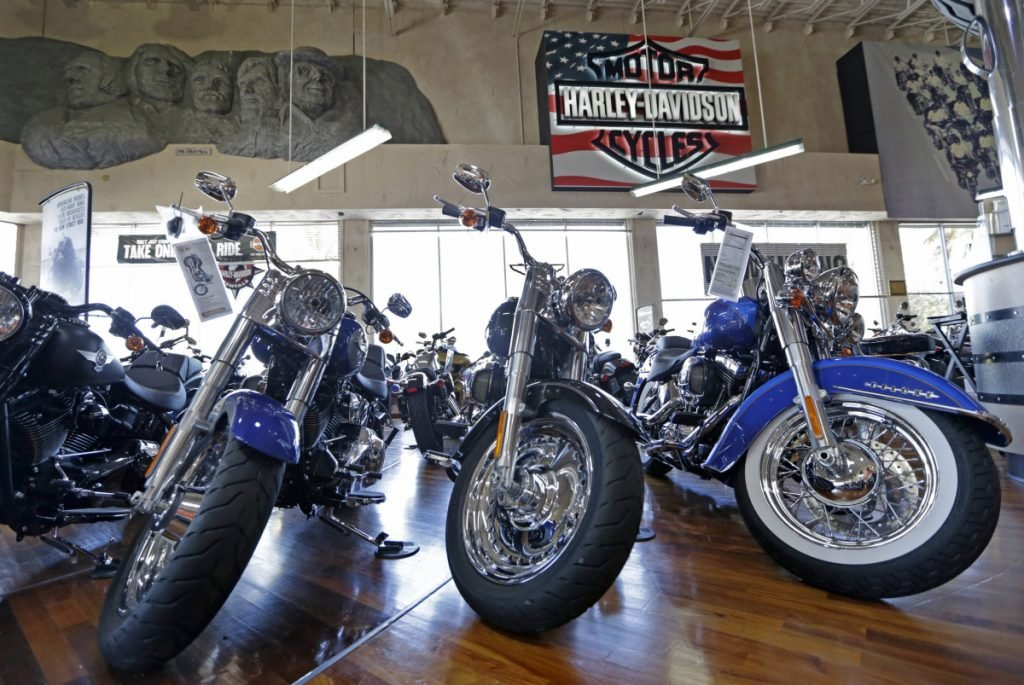 This Tuesday, April 25, 2017, photo shows Harley-Davidson motorcycles on display in the showroom at a dealership in Miami. On Wednesday, Sept. 27, 2017, the Commerce Department releases its August report on durable goods. (AP Photo/Alan Diaz)