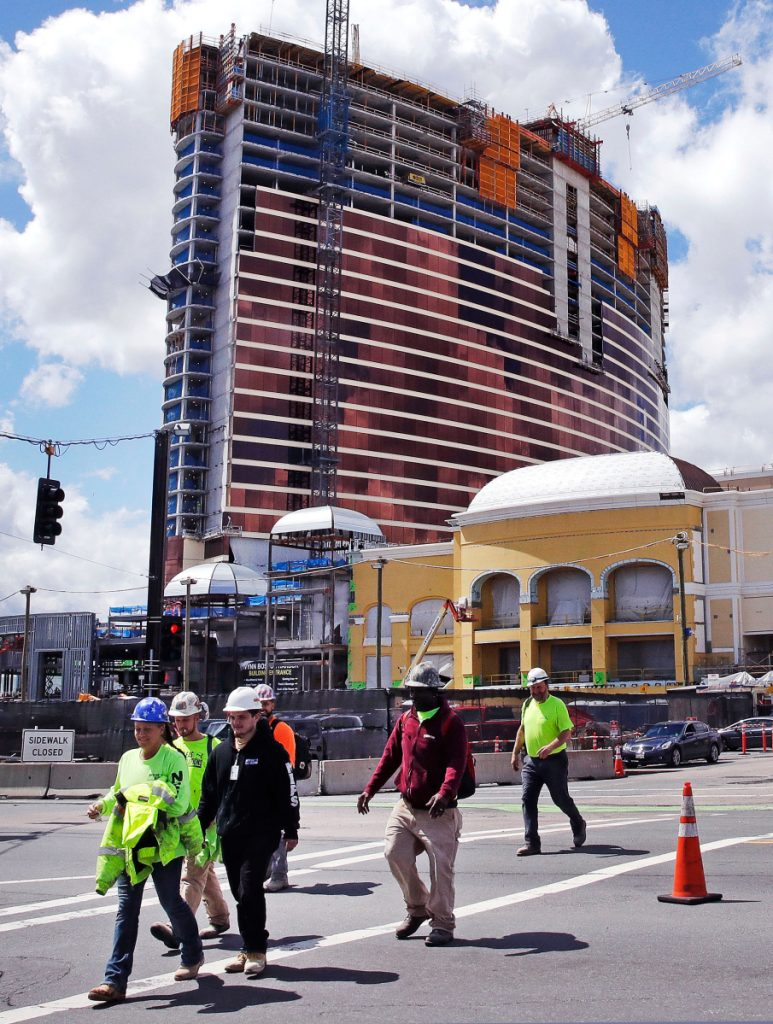 Construction continues on a $2.5 billion casino in Everett, Mass., but it will no longer be named after Wynn Resorts founder Steve Wynn, who faces multiple allegations of sexual misconduct.