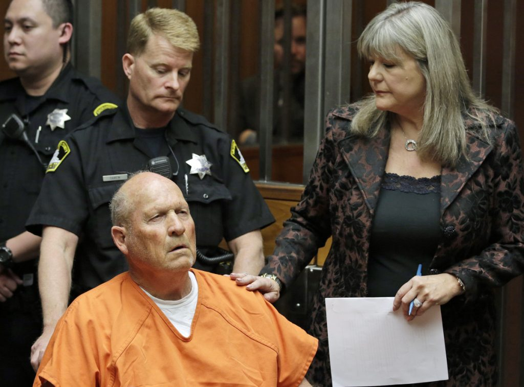 Joseph James DeAngelo, 72, who authorities suspect is the so-called Golden State Killer responsible for at least a dozen murders and 50 rapes in the 1970s and 80s,  is accompanied by Sacramento County Public Defender Diane Howard, right, as he makes his first appearance, Friday, April 27, 2018, in Sacramento County Superior Court in Sacramento, Calif. (AP Photo