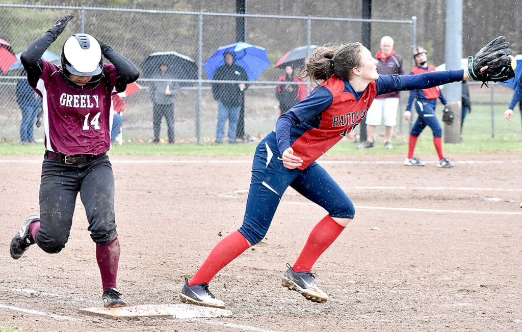 Kelsey Currier of Greely makes it to first as Gray-New Gloucester first baseman Jordan Grant reaches to catch a late throw Friday during Greely's come-from-behind 4-3 victory. Currier reached base four times.