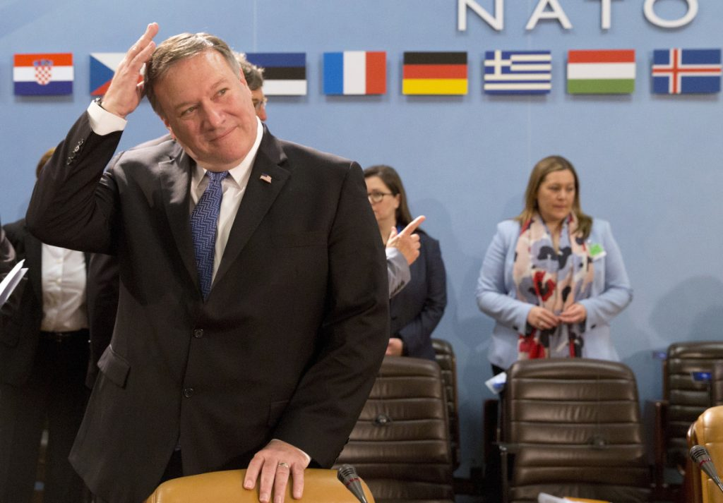 Secretary of State Mike Pompeo arrives for a meeting with the North Atlantic Council at NATO headquarters in Brussels on Friday. He later continued on to the Mideast.