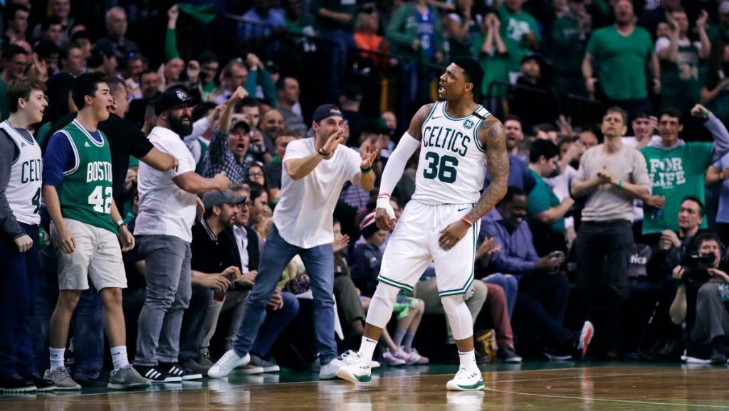 Celtics guard Marcus Smart celebrates a basket with fans during Game 7 of Boston's first-round playoff series Saturday night against the Milwaukee Bucks. The Celtics advanced with a 112-96 win.