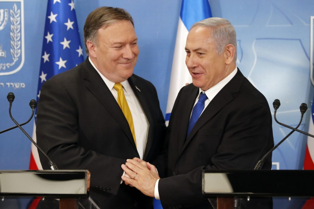 Secretary of State Mike Pompeo, left, is greeted by Israeli Prime Minister Benjamin Netanyahu ahead of a news conference at the Ministry of Defense in Tel Aviv on Sunday.