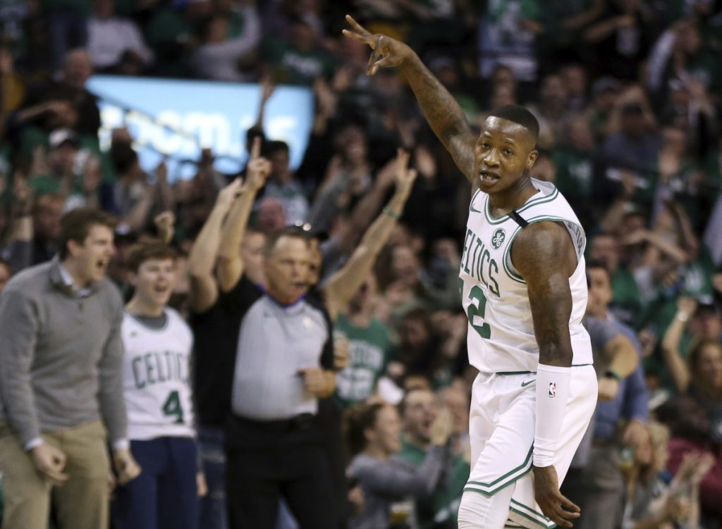 Celtics guard Terry Rozier celebrates his 3-point shot against the Philadelphia 76ers in the first quarter of the Celtics' 117-101 win in Game 1 of their second-round series on Monday in Boston.