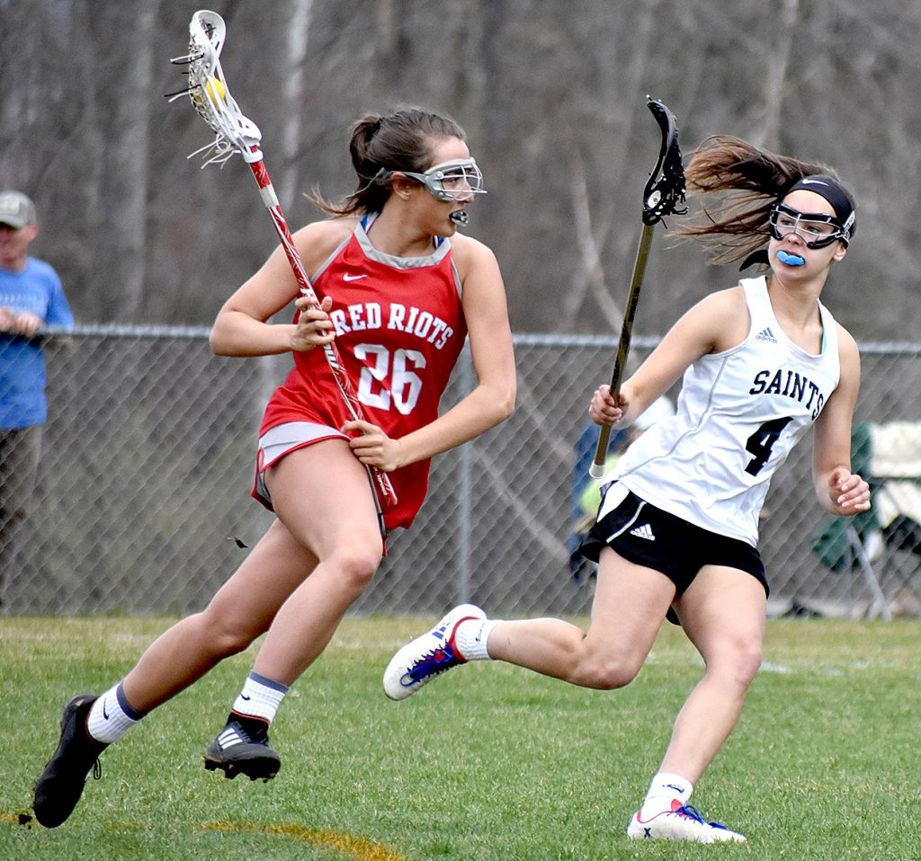 South Portland's Amelia Pappalardo goes on the attack against St. Dominic Academy's Rileigh Stebbins during their game in Auburn on Saturday. St. Dom's won, 20-6.