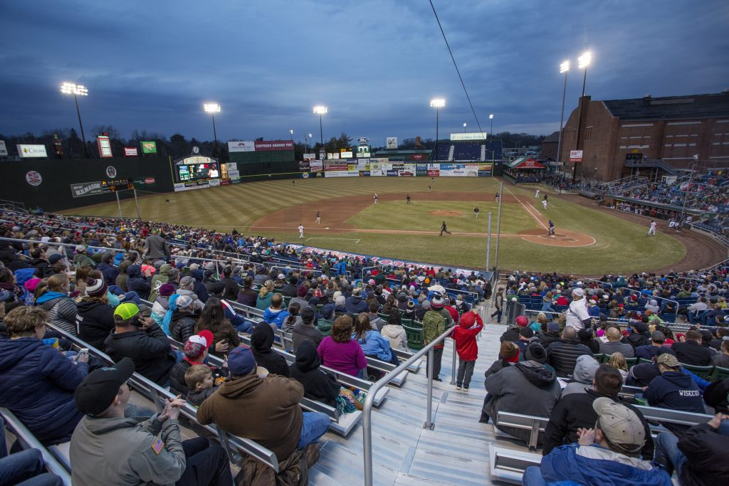 Fans cheer as the Sea Dogs get a hit on Friday night in their home opener at Hadlock Field.