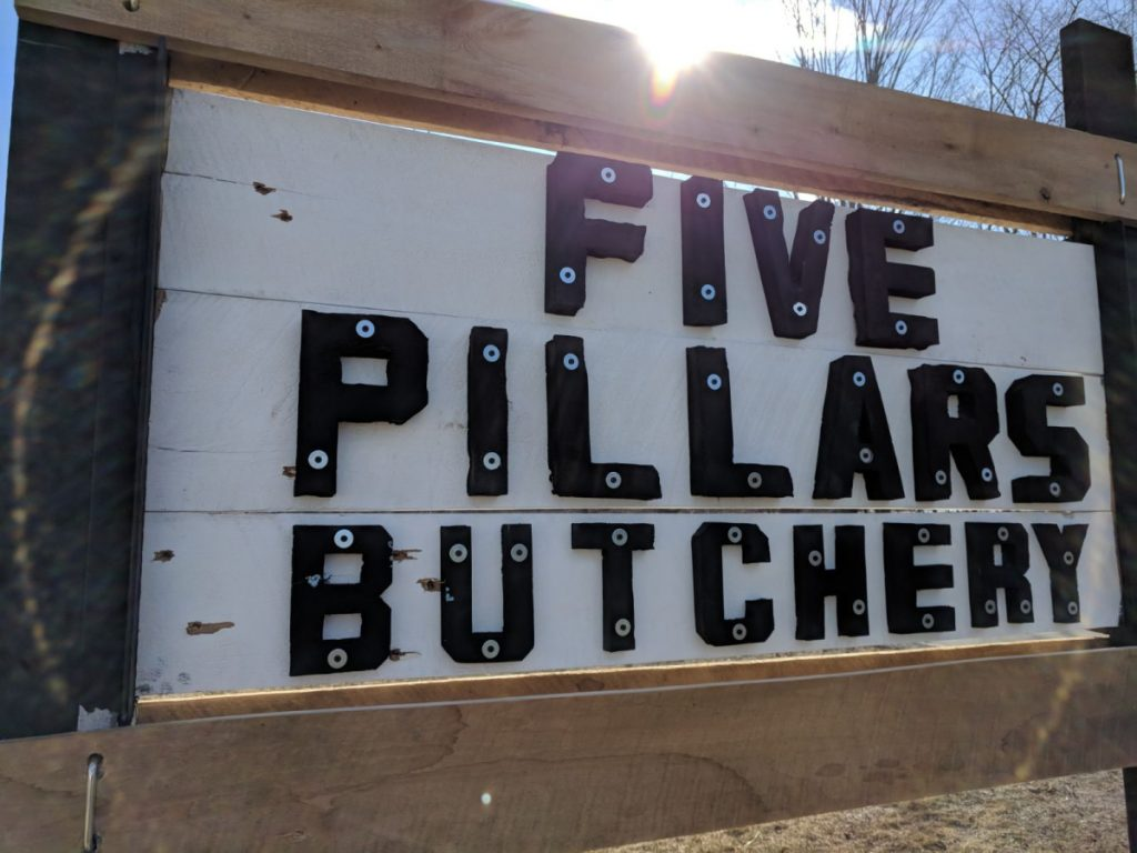 The sign advertising Hussam Alrawi's butchery in Troy had eight holes shot into it Sunday, shortly after he put it up.